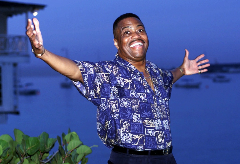 "FILE - In this Aug. 18, 1999 file photo, Cuba Gooding Sr. lead vocalist of the legendary r&b/pop group The Main Ingredient, and father of Oscar winning actor Cuba Gooding Jr., gestures during an interview in Bridgetown, Barbados. Gooding Sr., who sang the 1972 hit ""Everybody Plays the Fool,"" has died. Authorities say the 72-year-old singer was found dead due an unknown cause in a car Thursday, April 20, 2017, in the Woodland Hills section of Los Angeles. (AP Photo/Chris Brandis, File)"