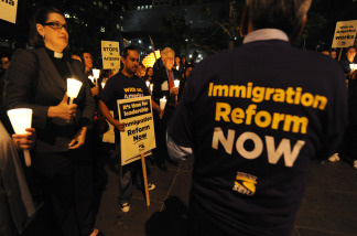 Janitors hold a candlelight vigil calling for federal immigration reform in response to Arizona's SB 1070 anti-illegal immigration law.