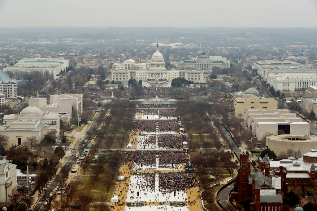 Attendees line the Mall as they watch ceremonies to swear in Donald Trump on Inauguration Day on January 20, 2017 in Washington, DC.