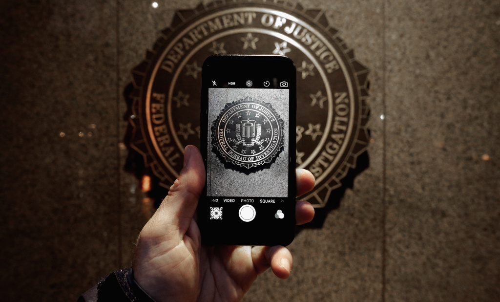 The official seal of the Federal Bureau of Investigation is seen on an iPhone's camera screen outside the J. Edgar Hoover headquarters in Washington, D.C.