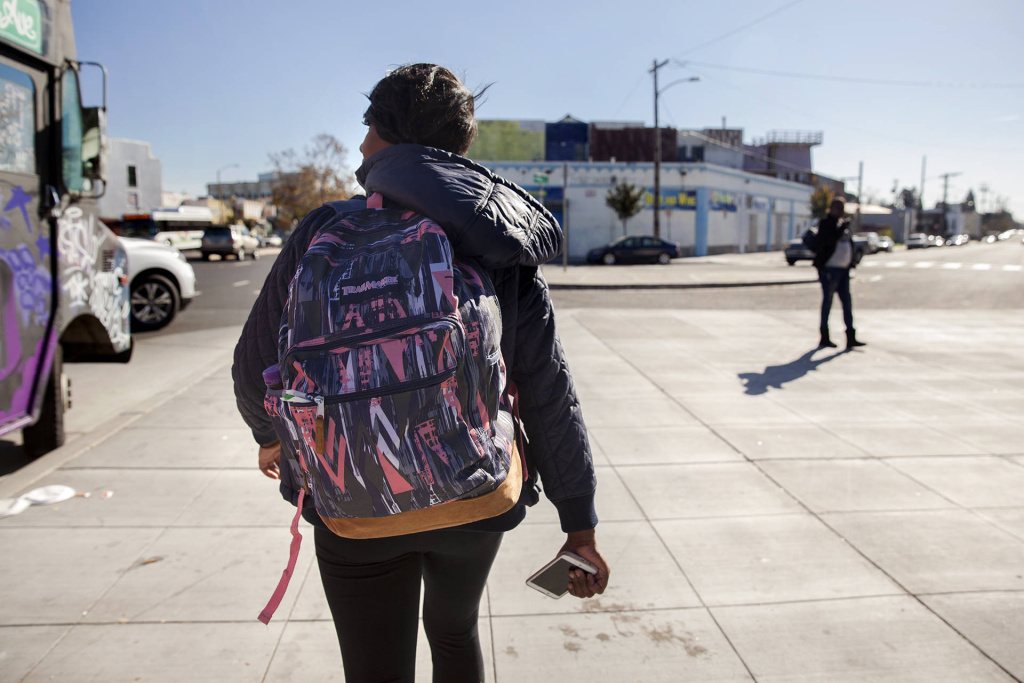 Brittany Jones, a student at Laney College, makes her way from class to her storage unit in West Oakland. Jones is currently homeless and spends up to three hours a day at her storage unit organizing her belongings, doing homework or relaxing.