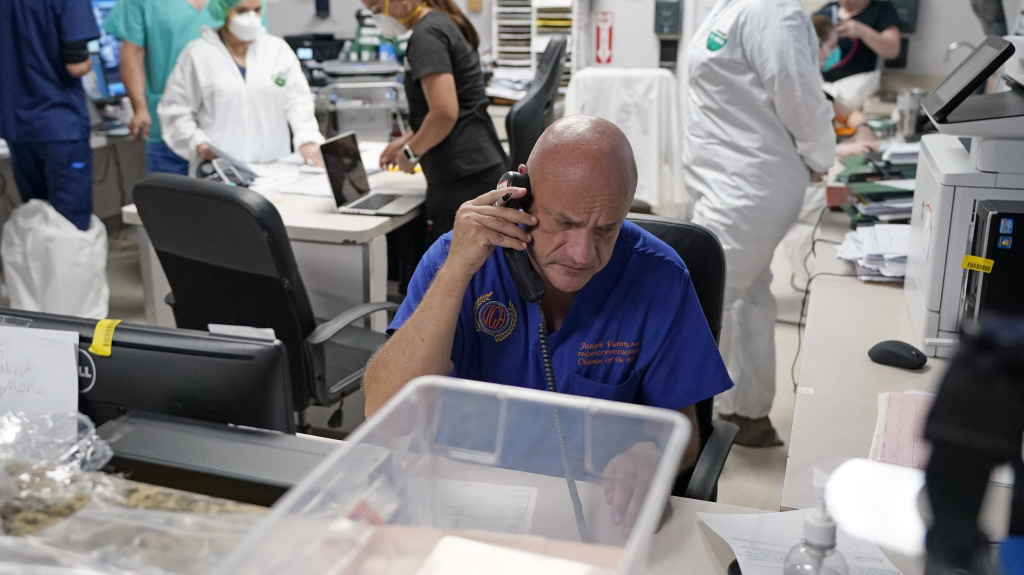 Dr. Joseph Varon notifies the family of a patient who died inside the coronavirus unit at Houston's United Memorial Medical Center on July 6. Varon tells NPR he's