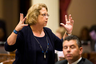 File photo: California State Sen. Denise Ducheny (D-San Diego) reacts to Republican efforts to hold up the vote on a solution to the state's budget problem on the evening of July 23, 2009 in Sacramento.