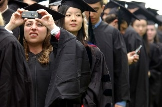 Ayah Bdeir, of Lebanon, takes a picture at the Massachusetts Institute of Technology (MIT) commencement ceremony.