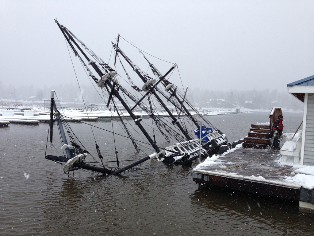 This Saturday, March 1, 2014 photo provided by the Big Bear Visitors Bureau shows a 43-foot pirate ship tour boat partially submerged under water in Big Bear Lake, Calif.  The 27-ton boat had been docked at Holloway Marina before sinking. The one-third scale 16th century Spanish galleon replica was a prop in the movie