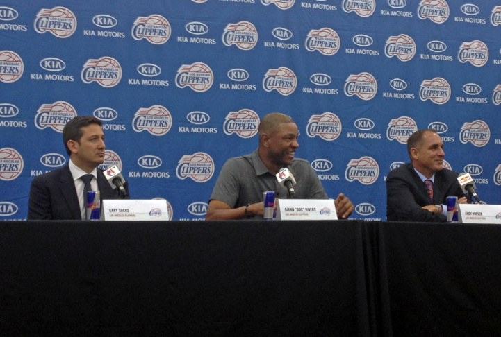 (L to R) Clippers vice president of basketball operations Gary Sacks; new Clippers coach Doc Rivers; Clippers President Andy Roeser on Wednesday, June 26, 2013.