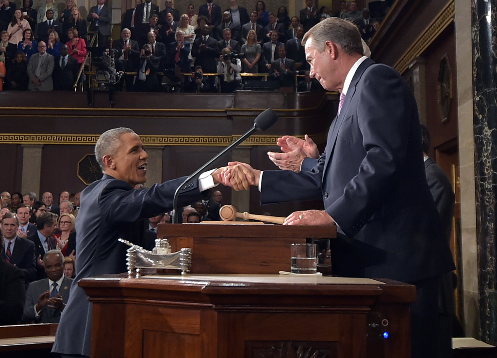 President Barack Obama shakes hands with Speaker of the House John Boehner as he arrives to deliver the State of the Union speech before members of Congress in the House chamber of the U.S. Capitol Jan. 20, 2015 in Washington, DC.