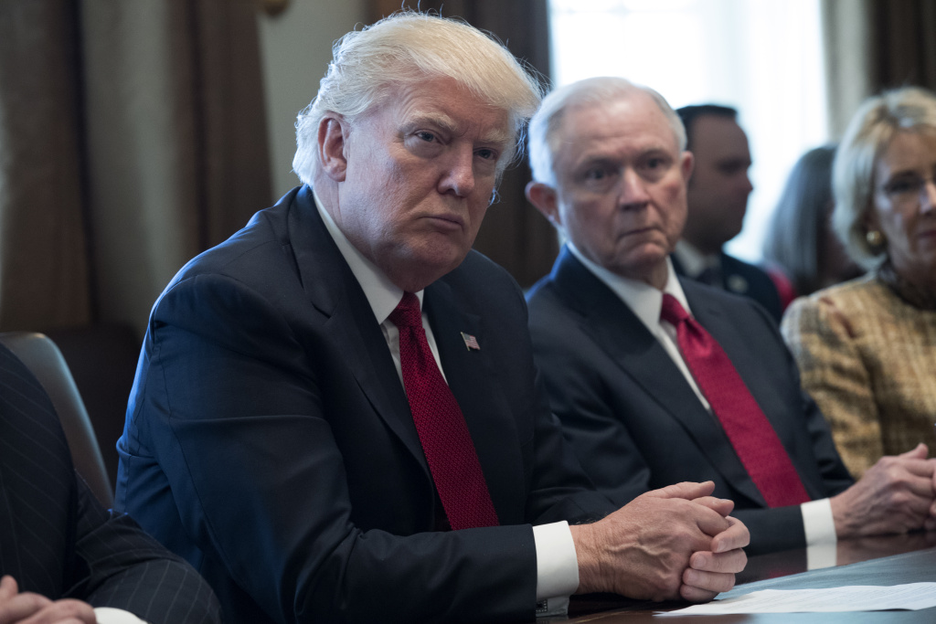 U.S. President Donald Trump (L) and Attorney General Jeff Sessions (R) attend a panel discussion in the Roosevelt Room of the White House March 29, 2017 in Washington, DC.