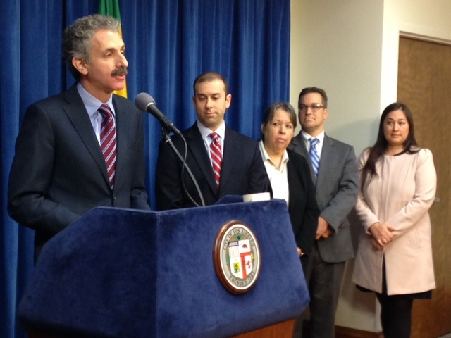 Los Angeles City Attorney Mike Feuer addresses reporters to announce plans to crack down on immigration scam artists. City and county officials are also planning outreach efforts to warn immigrants eager to apply for deportation relief under President Obama's new immigration plan, who are vulnerable to scams.