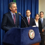 Los Angeles City Attorney Mike Feuer addresses reporters on Thursday to announce plans for a crack down on immigration scam artists. City and county officials are also engaging in outreach to warn immigrants who are eager to apply for deportation relief under President Obama's new immigration plan.