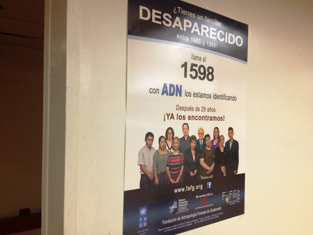 A poster on the wall at the Central American Resource Center near downtown Los Angeles promotes a Guatemala-based forensic anthropology NGO that was recently in town, collecting DNA samples from Guatemalan immigrants with loved ones who went missing in that country's civil war. The group works to exhume and identify the bodies of wartime