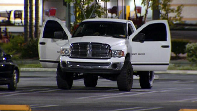 The white Ram pickup driven by two Marines contained non-lethal grenades