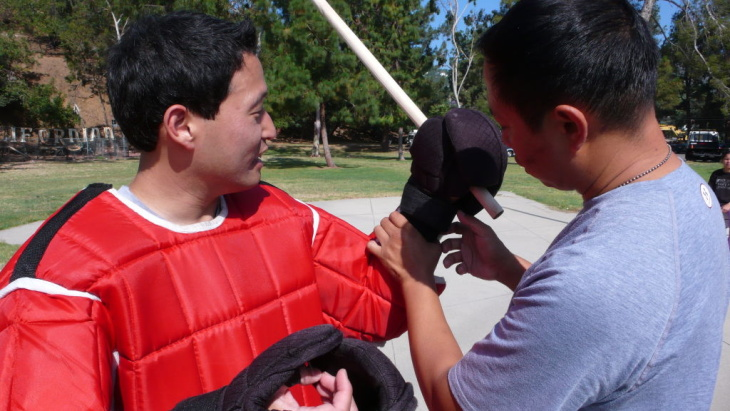 Reporter Jed Kim suits up for an eskrima sparring match