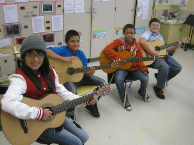 A teacher is able to supply guitars to his students thanks to gift card donations as part of a partnership between LAUSD and the Wasserman Foundation (using the online nonprofit DonorsChoose.org).