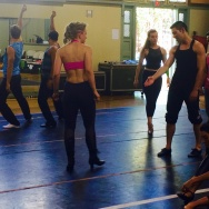 "The cast of ""A Chorus Line"" warms up for rehearsal in the gym at Hollywood United Methodist Church."