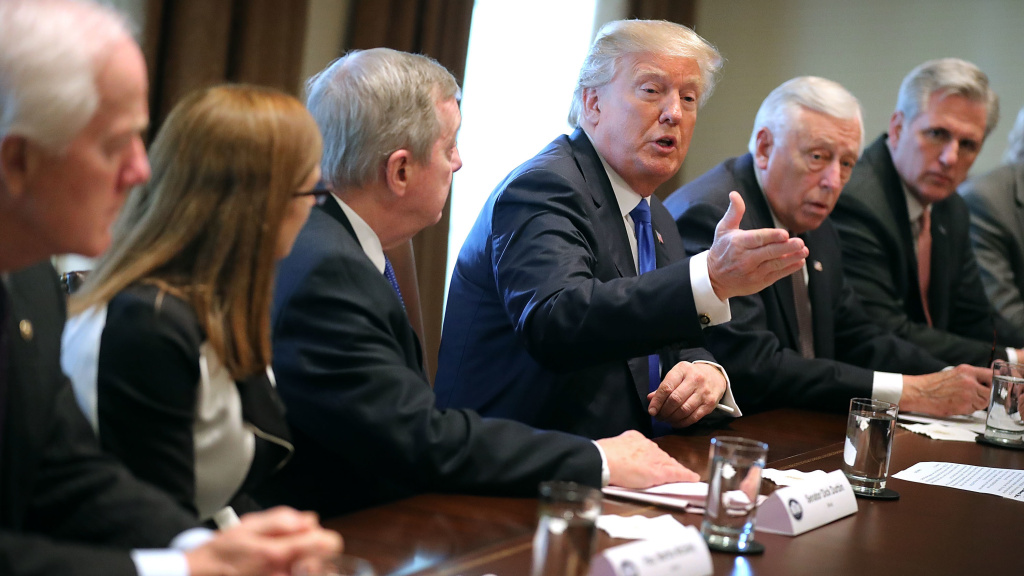 President Donald Trump presides over a meeting about immigration with Republican and Democrat members of Congress at the White House on Tuesday. Congress and the White House are trying to work out an immigration deal prior to January 19.