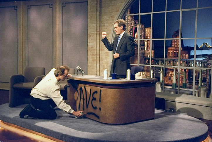 Bill Murray spray paints Dave's desk on the first taping of