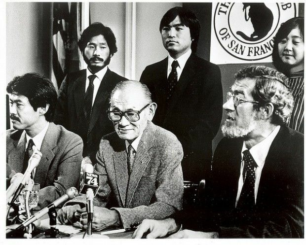 Fred Korematsu, seated center, at a 1983 press conference announcing the re-opening of his civil rights case.
