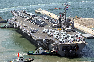 The 97,000-ton aircraft carrier USS George Washington arrives at the southern port city of Busan on July 21, 2010 for a five-day port call. The US aircraft carrier and three destroyers arrived in South Korea ahead of a naval exercise to deter North Korea following the sinking of one of Seoul's warships.