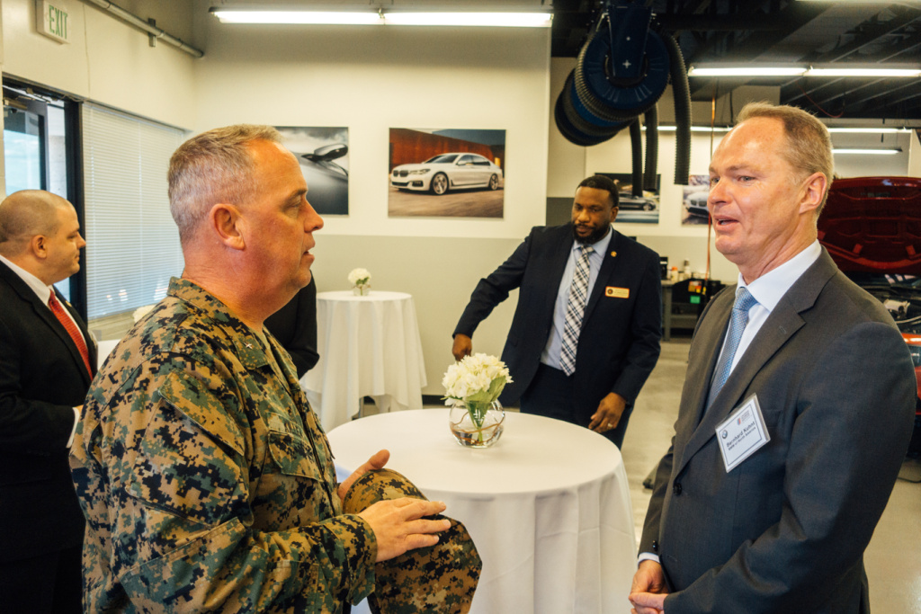 Brigadier General Kevin Killea (left) and Bernhard Kuhnt, CEO of BMW of North America.