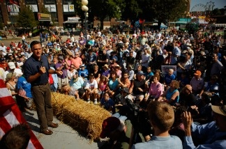 Republican presidential candidate Mitt Romney addresses a large audience during his time on the Des Moines Register's 'Soapbox' at the Iowa State Fair.