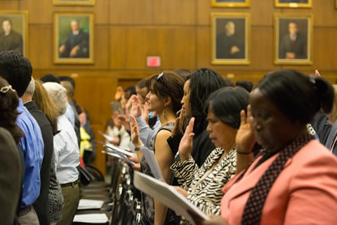A U.S. Citizenship and Immigration Services Naturalization Ceremony on May 13, 2014. 125 individuals from more than 50 countries take the oath at the naturalization ceremony.