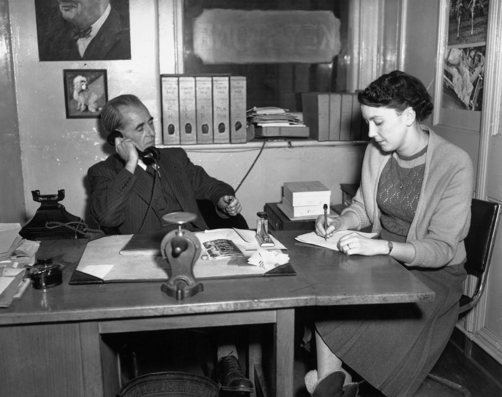 21st November 1951: Chief librarian Martin Prince and his secretary at work at Keystone Press Agency