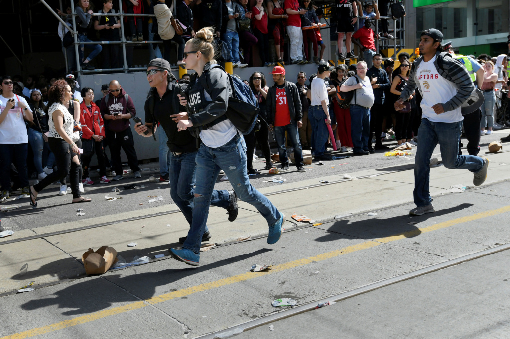 Crowds scatter after reports of shots fired in Nathan Phillips Square in Toronto in June. Tens of thousands of people were gathered in the area to celebrate the Toronto Raptors' victory parade. By the end of 2019, more than 760 people had been shot in the city, 44 of whom were killed, according to Toronto Police.