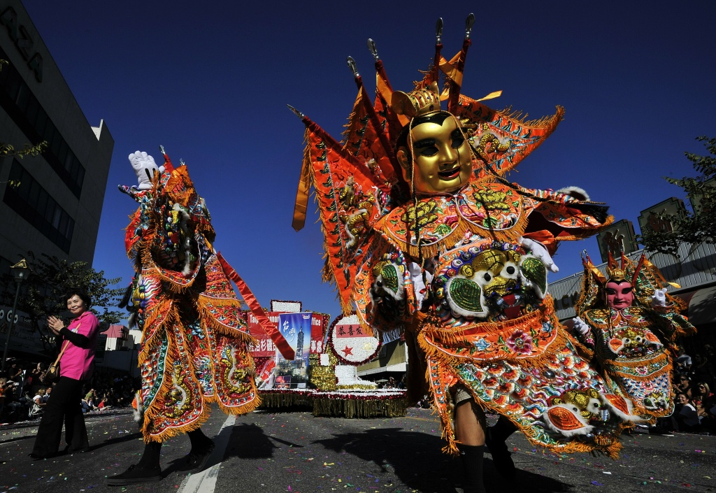 Costumed participants celebrate the Lunar New Year at the annual Golden Dragon Parade in Los Angeles's Chinatown on January 28, 2012.