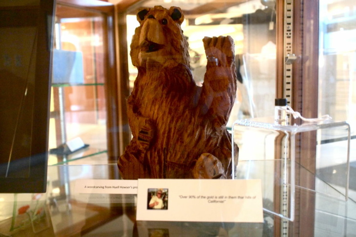 A friendly, wood carved bear greets visitors to the Chapman University Library. The bear was a gift to Huell from a fan.