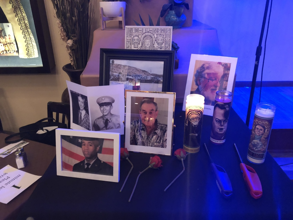 "Participants put photos and candles on a ""secular honoring table"" to remember dead loved ones."