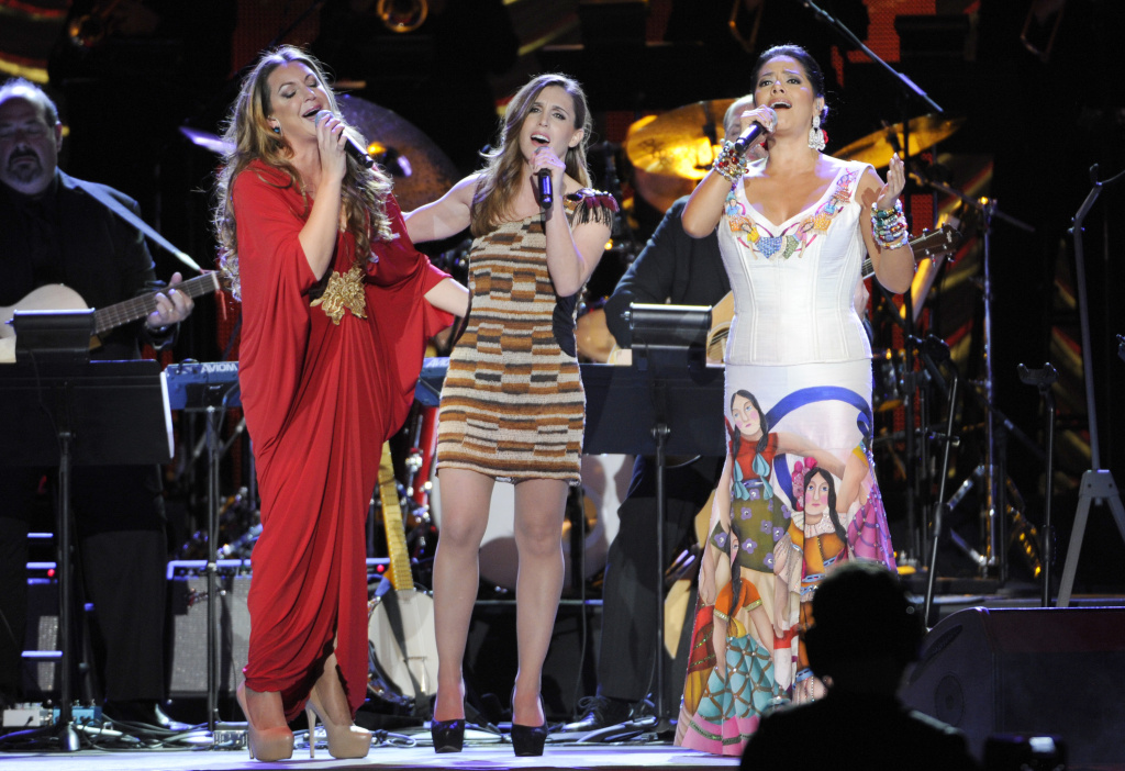 Soledad, and from left, Nina Pastori, and Lila Downs perform on stage at the Latin Recording Academy Person of the Year Tribute honoring Joan Manuel Serrat at the Mandalay Bay Resort and Casino on Wednesday, Nov. 19, 2014, in Las Vegas. (Photo by Chris Pizzello/Invision/AP)