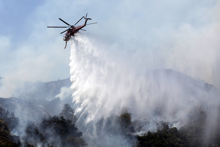 Aircraft make water drops over the San Gabriel Complex fire on Tuesday afternoon, June 21, 2016 in Bradbury near Spinks Canyon Road.