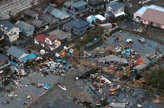 An aerial view shows debris that remained on the ground after a tsunami wave to have hit Hitachinaka city in Ibaraki prefecture on March 11, 2011.