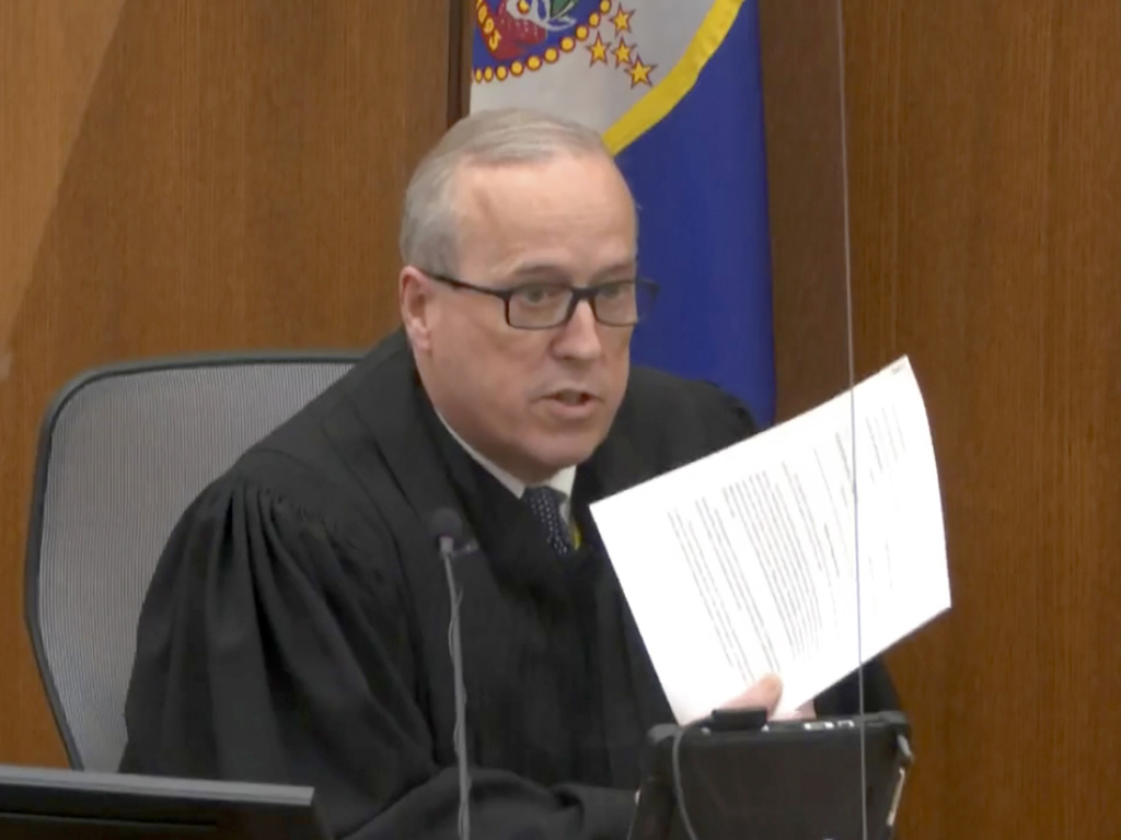 In an image taken from video on Monday, Hennepin County Judge Peter Cahill reads instructions to the jury before closing arguments in the trial of former Minneapolis police officer Derek Chauvin.