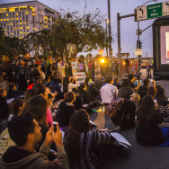 Onlookers watch as President Obama is shown on a projector near the intersection of Alameda St. and the 101 freeway in downtown Los Angeles on Thursday, addressing the nation with reformed immigration policy.    President Obama addresses the nation with reforms in immigration policy in downtown Los Angeles on Thursday Nov. 20, 2014.