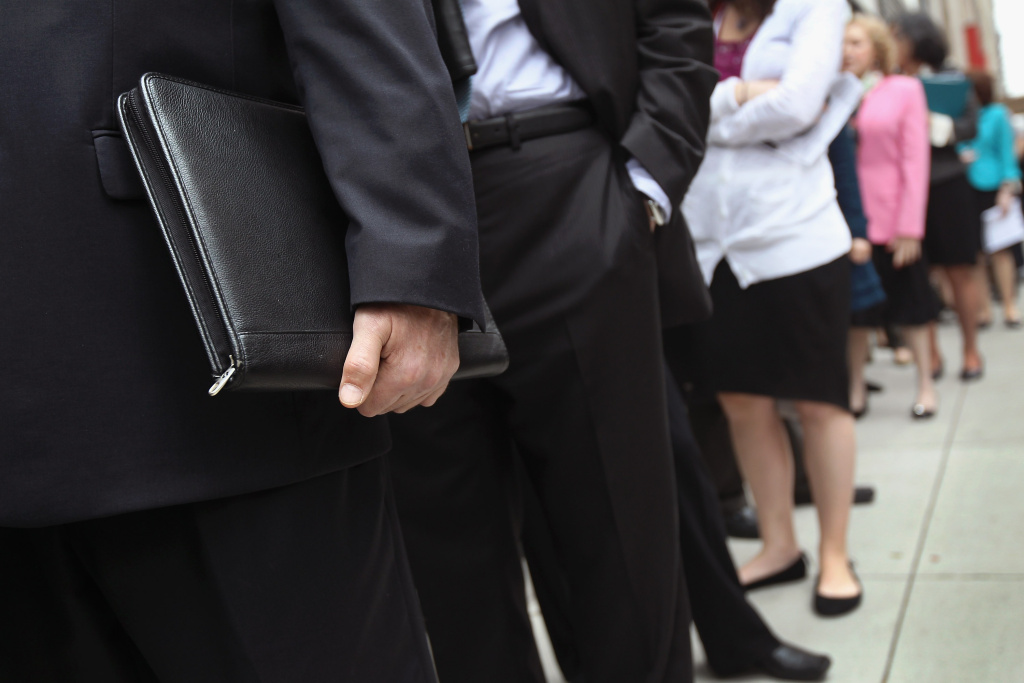 People stand in a line that stretched around the block to enter a job fair held at the Jewish Community Center in March 2012 in New York City. Congress has until December 28th to extend unemployment benefits.