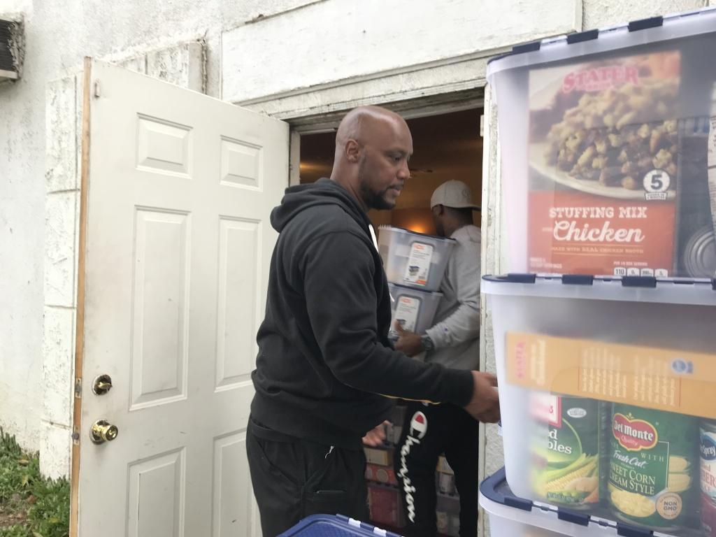 Pastor Darryl Jackson unloads boxes of donated food at Love Chapel in Ontario, Jan. 15 2019 (David Wagner/KPCC).