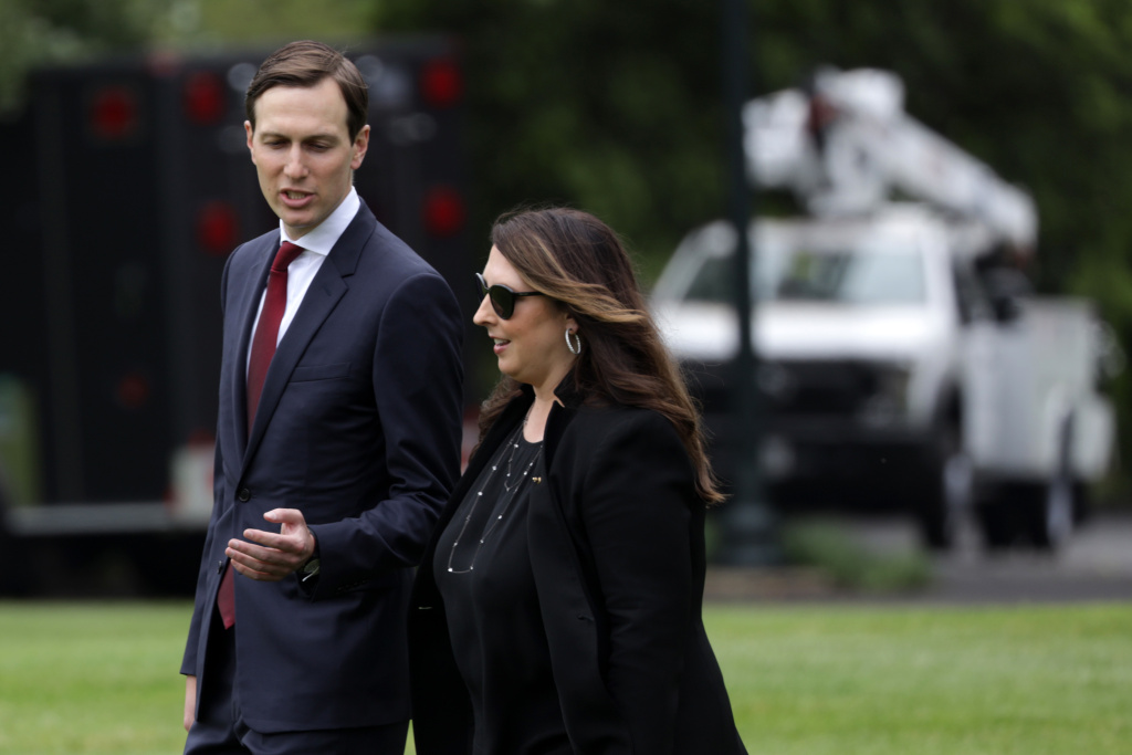 Republican National Committee Chair Ronna McDaniel walks with White House senior adviser Jared Kushner on the South Lawn of the White House in May. She is describing the August convention as a