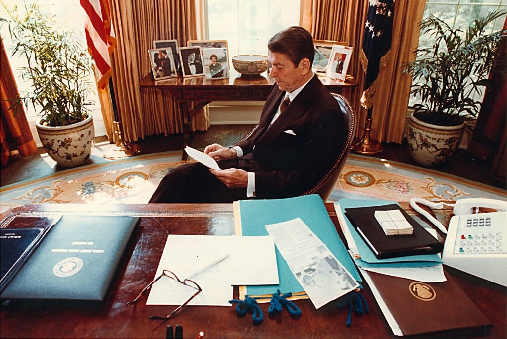 WASHINGTON - APRIL 28, 1981: (FILE PHOTO) Former U.S. President Ronald Reagan prepares a speech at his desk in the Oval Office for a Joint Session of Congress on April 28, 1981. In 1986, Reagan signed the Immigration Reform and Control Act, the last major comprehensive overhaul of the nation's immigration system, which granted amnesty to roughly 3 million undocumented immigrants. Other comprehensive reform attempts failed in 2006 and 2007.
