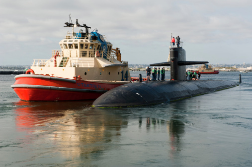 The Los Angeles-class attack submarine USS San Francisco (SSN 711) returns to Naval Base Point Loma from a daylong distinguished visitor embarkation. Navy officials are investigating a report of an armed man at Naval Base Point Loma.