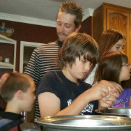 The Packer family gathers in the kitchen to cook dinner. From left: Jacob, 8; Brian Sr. ;Brian Jr., 11;  Savannah, 5; Scarlett, 10; and Stephanie.