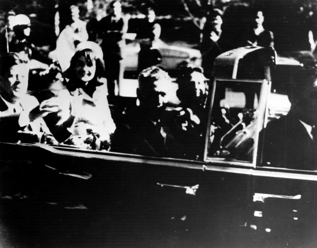 President John F. Kennedy and his wife Jacqueline Kennedy ride with secret agents in an open car motorcade shortly before the President was assassinated in Dallas, Texas, November 22, 1963.