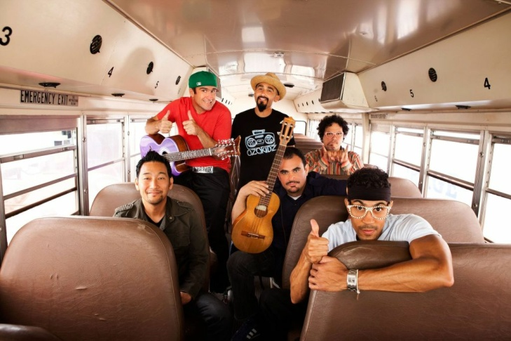 The LA-based band Ozomatli pose for a promotional photo.