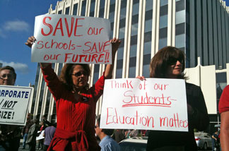 Public school educators from north Orange County protest to preserve education funding in front of the Fullerton offices of Republican state Assemblyman Chris Norby. Orange County, home to a strong anti-tax contingent, will also have its schools face millions in cuts should Prop. 30 not pass Tuesday.