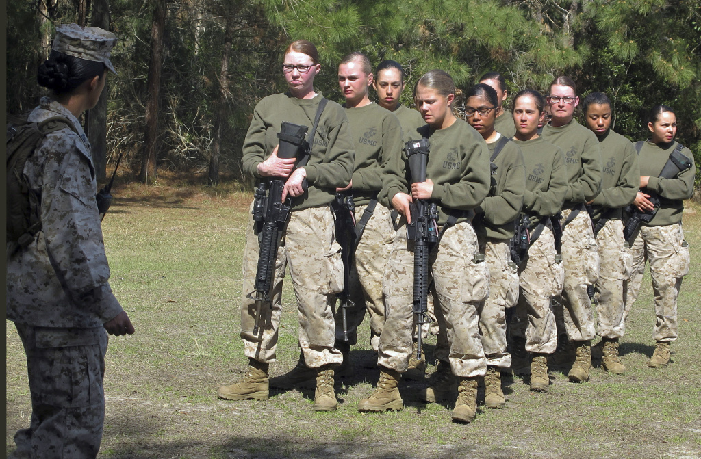 In this Feb. 21, 2013 file photo, female recruits stand at the Marine Corps Training Depot on Parris Island, S.C. Now, the Marines are considering allowing female to participate in a combat training program in SoCal.
