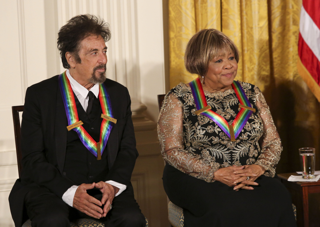 WASHINGTON, DC - DECEMBER 4: Actor Al Pacino, and singer Mavis Staples listen to President Barack Obama speak during a ceremony for the 2016 Kennedy Center honorees December 4, 2016 in the East Room of the White House in Washington, DC. The honorees include Eagles band members, actor Al Pacino, singer James Taylor, pianist Martha Argerich and singer Mavis Staples. (Photo by Aude Guerrucci-Pool/Getty Images)