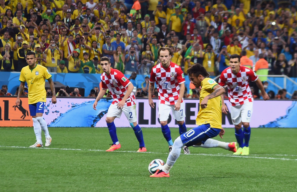 Neymar of Brazil takes a penalty kick during the 2014 FIFA World Cup Brazil Group A match between Brazil and Croatia at Arena de Sao Paulo on June 12, 2014 in Sao Paulo, Brazil.