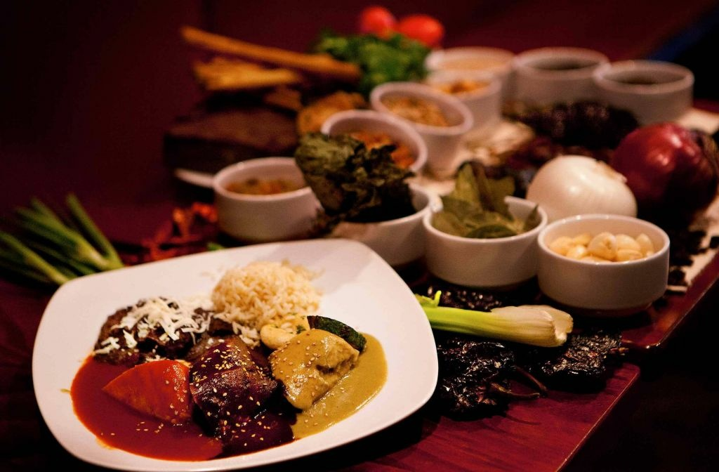 Three of the six moles served at Casa Oaxaca of Washington, D.C. Some of these mole recipes were passed down to chef Alfio Blangiardo by his grandmother.