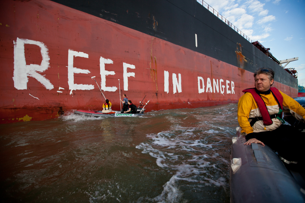 In this handout photo provided by Greenpeace, Activists paint the message